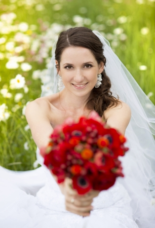bridal veil: Bride in white wedding dress at the meadow