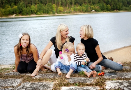 Family time by the lake in summer time photo