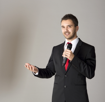 Handsome businessman is speaking on conference in hotel Stock Photo