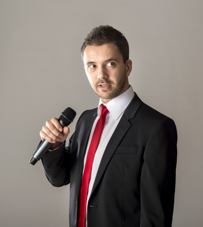 Handsome businessman is speaking on conference in hotel photo