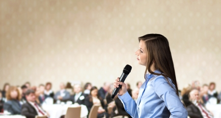 conference centre: Beautiful business woman is speaking on conference