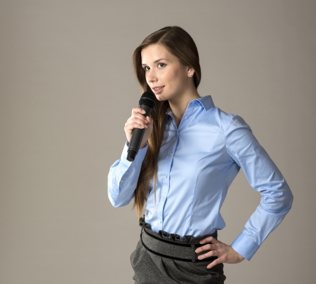 Beautiful business woman is speaking on conference  photo