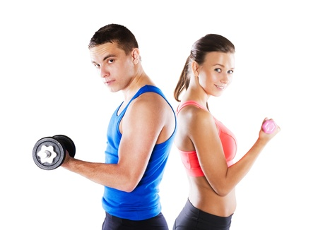 woman lifting weights: Athletic man and woman before fitness exercise Stock Photo