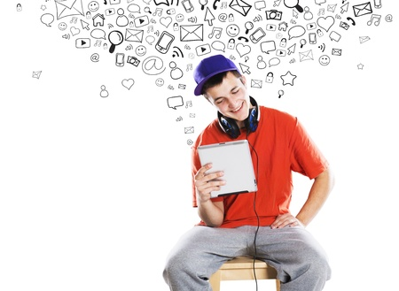 headset symbol: Handsome young man with tablet is using social media
