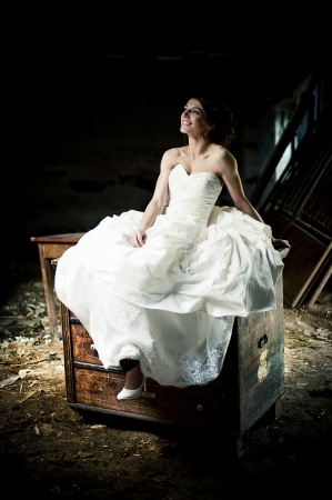 Lovely and happy brunette bride posing outdoor Stock Photo - 21811875