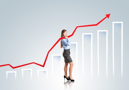 Business woman is trying to increase market statistics  Stock Photo