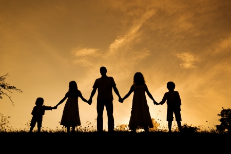 family of five: Silhouettes of happy parents having fun with their children