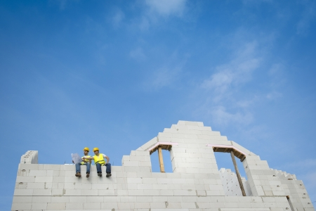 artisan: Construction Contractors building a big new home Stock Photo