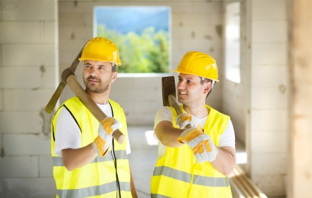 Construction workers collaborating on new house building photo
