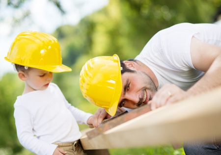 Little son helping his father with building work Stock Photo - 22216118