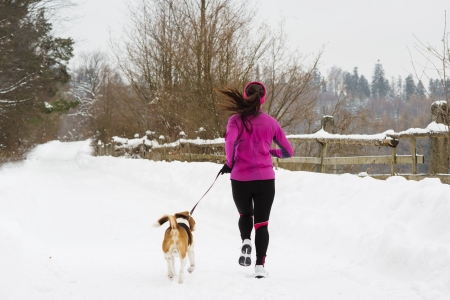 Woman is walking during winter with her dog photo