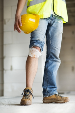Construction worker has an accident while working on new house photo