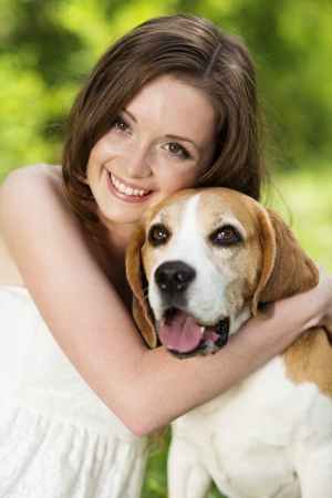 Portrait of a woman with her beautiful dog outdoors photo
