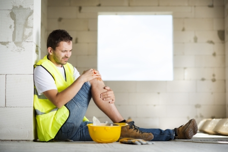 Construction worker has an accident while working on new house Stock Photo - 22225645