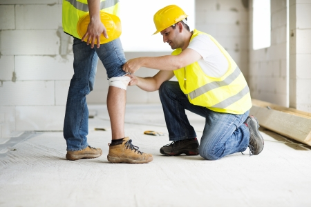 men at work: Construction worker has an accident while working on new house