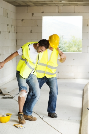 accident at work: Construction worker has an accident while working on new house