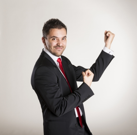 Successful business man is posing in studio photo