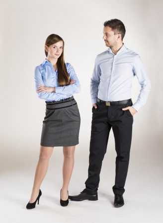 Successful business couple is standing in studio photo