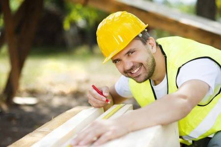 wood craft: Construction worker is working with wooden beam