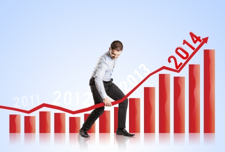 Business woman is trying to increase market statistics Stock Photo - 22501881