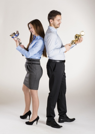 Successful business couple is standing in studio Stock Photo