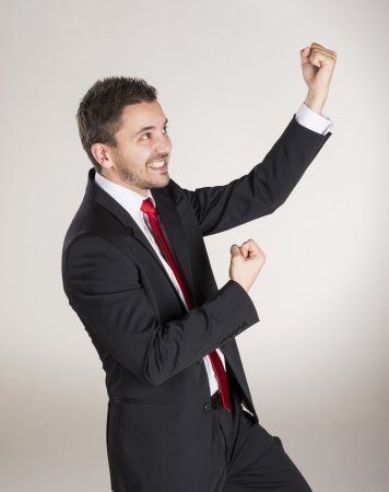 Successful business man is posing in studio Stock Photo - 22564912
