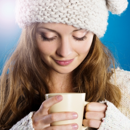 Young beautiful girl smiling in warm winter clothes