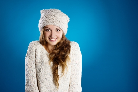 Young beautiful girl smiling in warm winter clothes photo