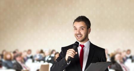 Man is speaking on indoor business conference for managers  photo