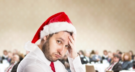 stressed man: Funny businessman with christmas cap is on conference
