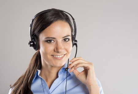 telephone operator: Beautiful call center young woman ready for support and contact Stock Photo
