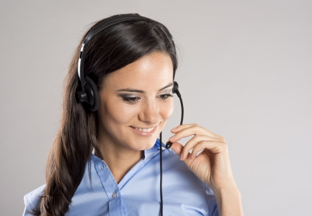 Beautiful call center young woman ready for support and contact photo