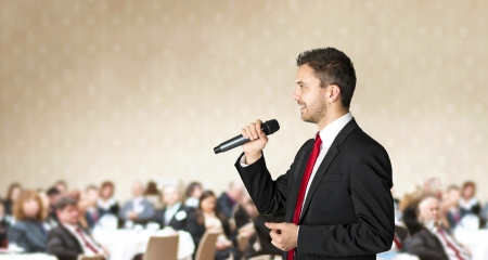 spokesman: Man is speaking on indoor business conference for managers  Stock Photo