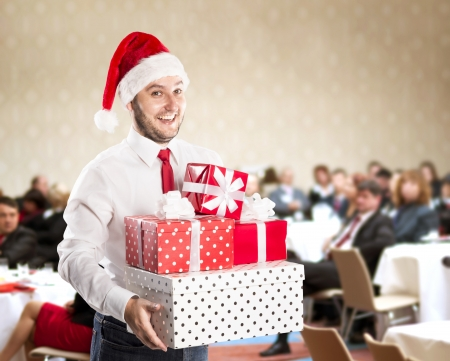 Funny businessman with christmas cap is on conference photo