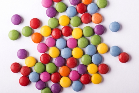 Studio concept with small round colorful candies Imagens