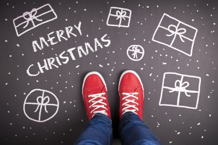 sneaker: Christmas concept with red shoes and white chalk Stock Photo