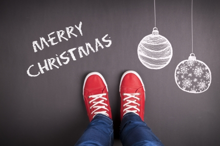 Christmas concept with red shoes and white chalk Stock Photo - 22902725