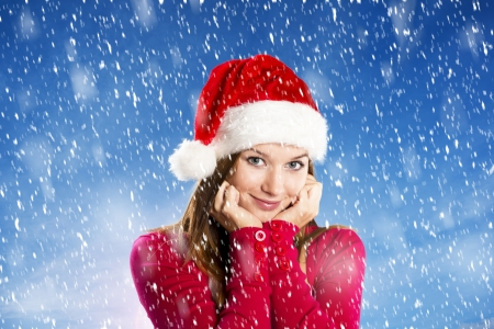 Beautiful woman with christmas hat in winter nature photo