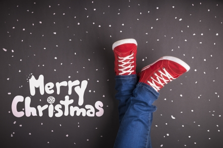 Christmas concept with red shoes and white chalk photo
