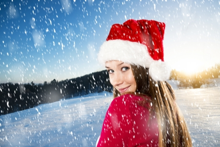 Beautiful woman with christmas hat in winter nature Stock Photo - 22902811