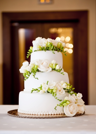 Beautiful and tasty wedding cake at wedding reception photo