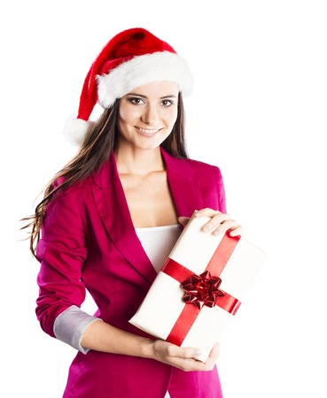 Beautiful woman with christmas hat is holding gift  Isolated on white background  photo