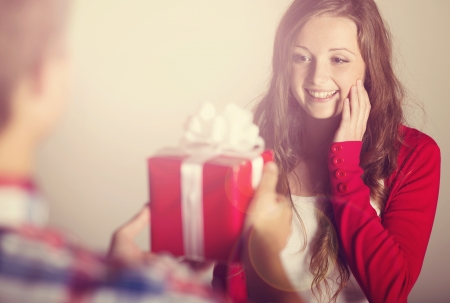 wrapped gift: Beautiful woman with gift