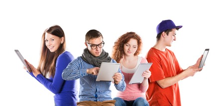Group of young people with pc tablet, isolated on white background photo