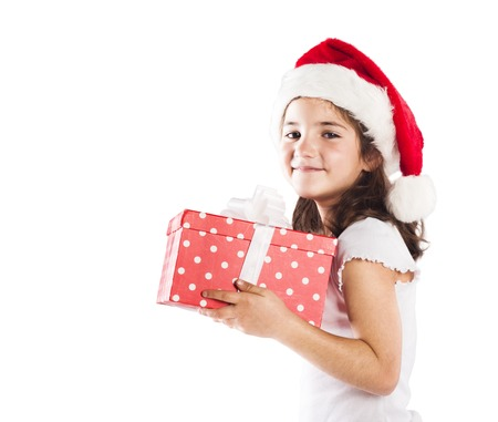 Happy small girl in santa hat with christmas gift photo