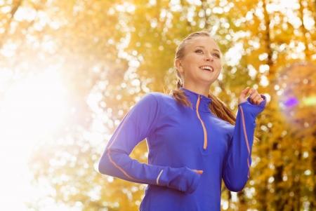 autumn young: Bautiful running woman jogging in autumn nature Stock Photo