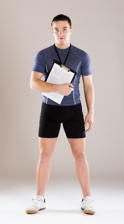 Young professional fitness coach standing in studio photo
