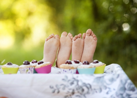 Two happy feet having picnic outside in summer photo