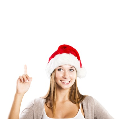 Portrait of attractive woman isolated on white, studio shot in christmas hat photo