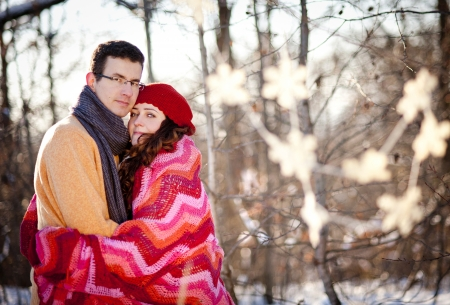 Young pregnant couple havin fun in winter country in snow photo